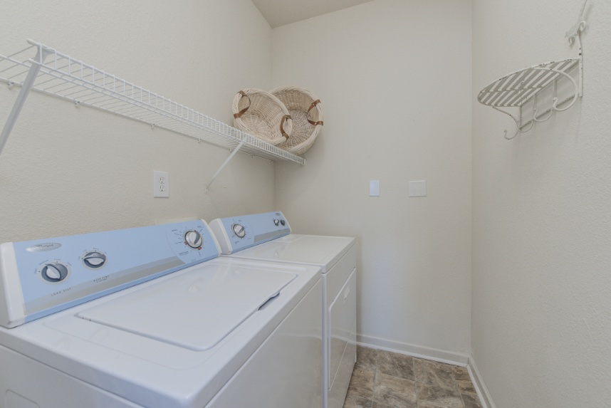 Laundry room with storage space in Greenwood.
